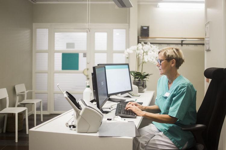 Side view of senior man using laptop