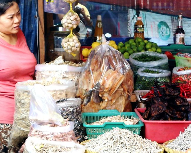 Traditional dried salted fish seller of Indonesia Activity Market Stall Flea Market Food Food And Drink Retail  Business Finance And Industry Business One Woman Only Freshness