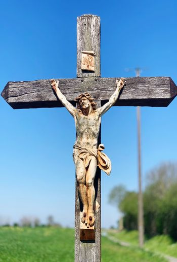 Jesus Cross Belief Religion Spirituality Sky Nature Day Crucifix No People Blue Symbol Clear Sky Cross Shape Outdoors Plant Low Angle View Grass