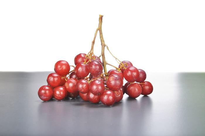 crimson grape on dark grey background Bunch Cluster Crimson Crimson Grape Fruit Grape Juicy Red Vitamin
