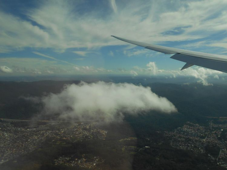 """Flying Over the State of São Paulo, Brazil into Guarulhos International Airport - """"Touch The Sky"""" #EyeEmReady Airplane Travel Anticipation Daytime EyeEm Brasil EyeEm Brazil EyeEm Ready   Flying High Susan A. Case Sabir Touch The Sky Unretouched Photography Aerial Photography Aerial View Airplane Wing Beauty In Nature Bright Sunlight Close To The Universe Flying In The Sky Flying Over Brazil Horizon Over Land Landscape No People Over The World Ready To Land Suspended In The Air"""