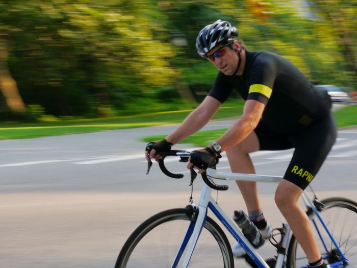 Activity Adults Only Athlete Bicycle Blurred Motion Central Park Competition Cycling Endurance Exercising Headwear Healthy Lifestyle Men Mode Of Transport Motion Only Men Pedal People Professional Sport Racing Bicycle Riding Speed Sport Sports Race Sportsman