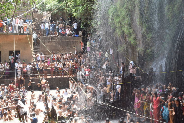 Large Group Of People Crowd Spraying Real People Men Water Enjoyment Lifestyles Tree Women Fun People Outdoors Arts Culture And Entertainment Leisure Activity Day Togetherness Adults Only Adult City