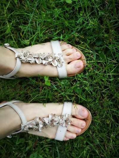 EyeEm Selects Low Section Human Leg Shoe Pair Sandal High Angle View Fashion Human Foot Close-up Grass Flip-flop Soccer Shoe Footwear Footwear Things That Go Together Flat Shoe Grass Area Grass Area Grass Area Jersey Fabric Trousers Wooden Floor Ground Toenail Feet Human Toe Kicking Toe