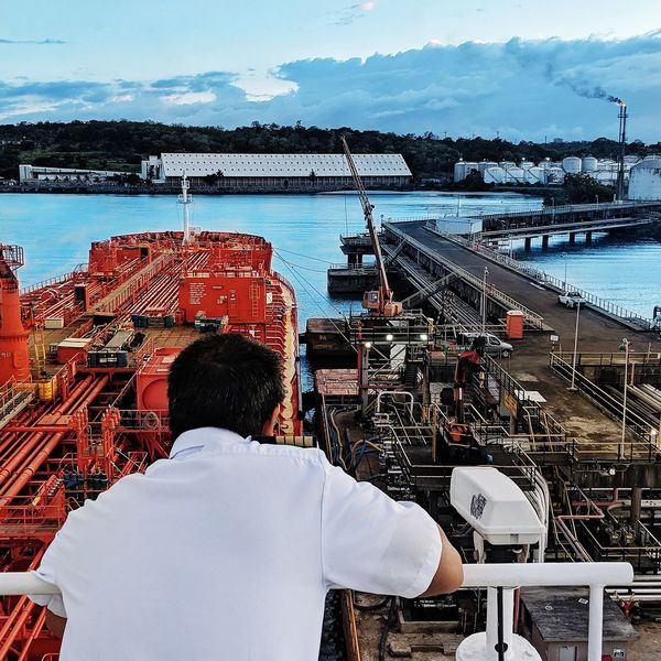 Nautical Theme Nautical Vessel Cargo Ship Life Onboard Tanker Ship Water Vehicle Working Water Sea Men Occupation Manual Worker Rear View Standing Sky