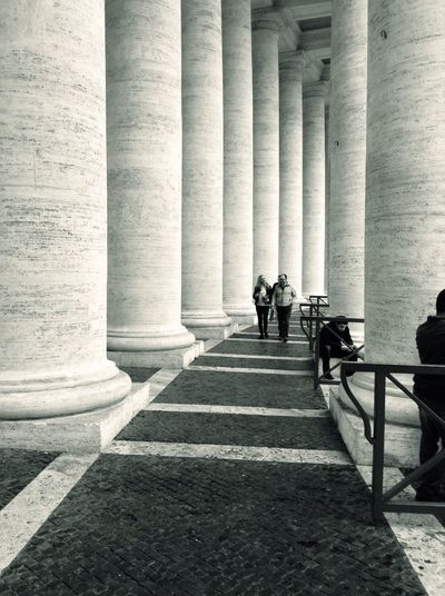 People walking in column of St Peters Square