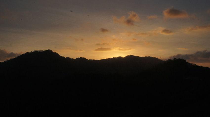 sunset at wadaslintang lake Beauty In Nature Cloud - Sky Dark Mountain Nature No People Orange Color Outdoors Sky Sunset