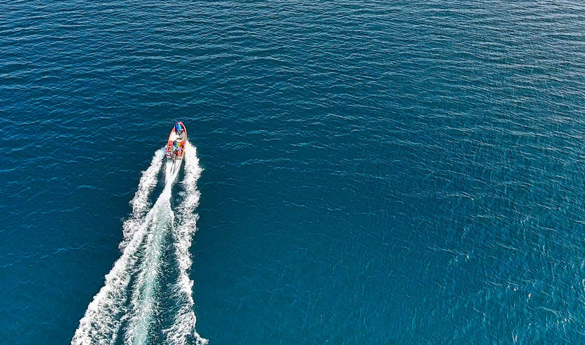 Aida Cara Adventure Aerial View Beauty In Nature Day High Angle View Jet Boat Leisure Activity Lifestyles Men Nature Nautical Vessel One Person Outdoors People Real People Sailing Sea Transportation Wake Wake - Water Water Women