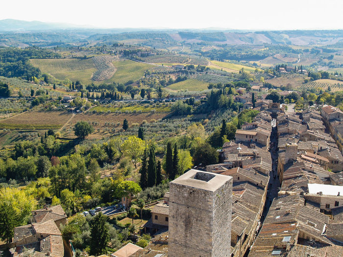 top view of san gimignano, tuscany, italy San Gimignano Travel Tuscany Ancient Ancient Civilization Architecture Beauty In Nature Building Building Exterior Built Structure Day Destination Heritage High Angle View History Italy Landscape No People Old Outdoors Sky The Past Togetherness Tower Travel Destinations