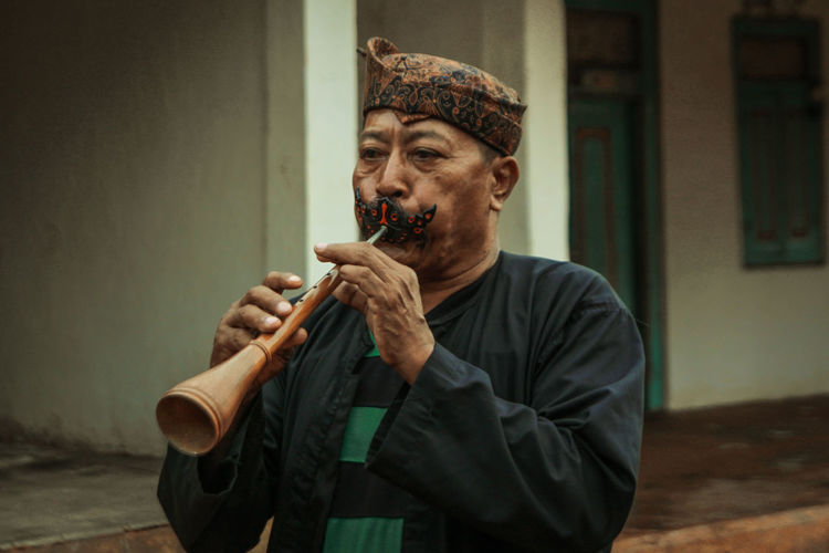 Man Playing Traditional Wind Instrument