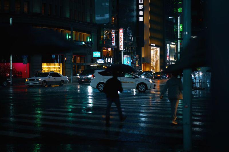 City View  City Lights Zebra Crossing Rainy Night Tokyo Street Photography City Car Transportation Motor Vehicle Mode Of Transportation Architecture Built Structure City Life Real People Wet Umbrella Rainy Season Road Land Vehicle City Street Illuminated Building Exterior Street Night Rain