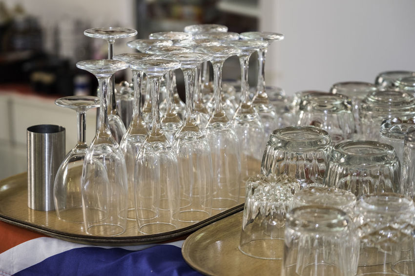 Trays with glasses of various sizes, including napkin holder. Tray Wine Glass Brandy Glass Cafe Close-up Cut Glass Pattern Day Drinking Glass Indoors  Napkin Holder No People Reflections Table Wineglass Wooden Tray