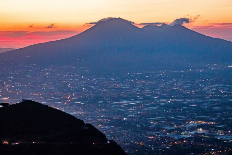 A view of Mount Vesuvius and the Gulf of Naples from the car park on the road to Corbara Beauty In Nature Cityscape Dusk Landscape Mountain Nature Scenics Silhouette Sky Sunset Tranquil Scene Tranquility Travel Destinations Twilight Twilightscapes Vesuvio Volcano Volcano Landscape