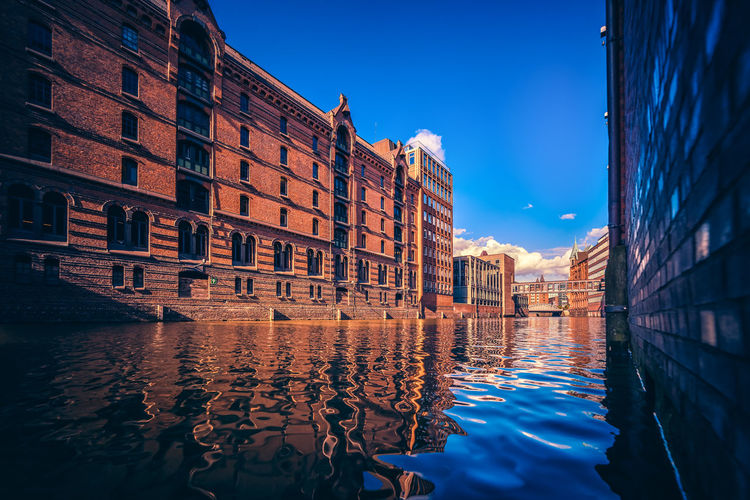 The bottom up view on the river in warehouse district of Hamburg with the beautiful reflection in the water Architecture Building Exterior Built Structure Canal City Day Nature No People Outdoors Reflection Rippled Sky Sunlight Water Waterfront