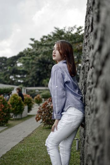 Anna at Bandung Lautan Photographer 2017 Bandung Shooter Indonesian Shooter Casual Clothing Day Grass Leisure Activity Lifestyles Nature One Person Outdoors Real People Side View Sky Standing Tree Tree Trunk Young Adult Young Women
