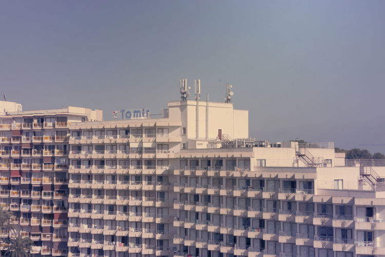 City buildings against blue sky