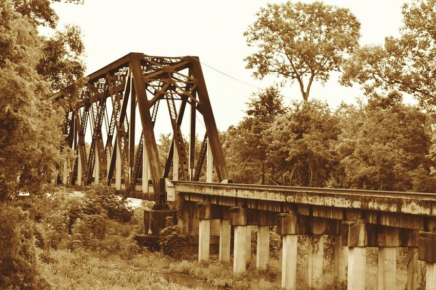 day tripping-photo safari No People South Louisiana Metal Trees Metal Structure Railroad Track Railway Bridge Trussel Columns Sepia