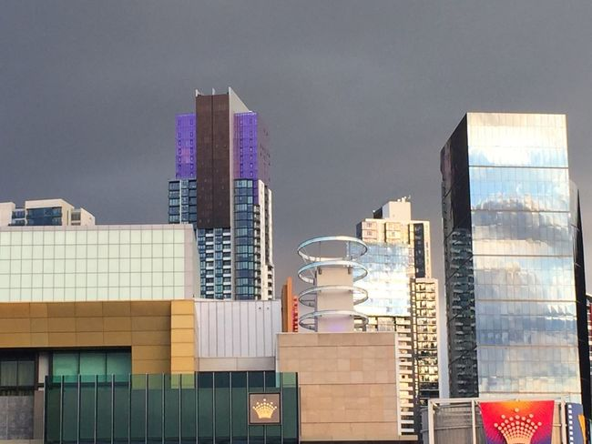 Gray crown Architecture Building Exterior Built Structure Skyscraper Modern City No People Outdoors Sky Day Growth Gray Reflection Crown Crown Casino Cityscape Futuristic Architecture Futuristic Skyline Melbourne City Melbourne Storm Clouds The Graphic City Colour Your Horizn