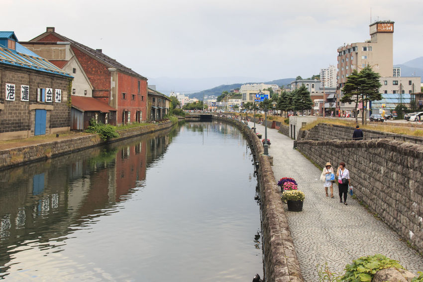 Otaru, Hokkaido - July 13,2015: Otaru, historic canal and warehousedistrict in Hokkaido, Japan, with many tourists walking by Architecture Building Exterior Built Structure Canal City City Life Day Furano Hokkaido House Japan Japan Photography Otaru Outdoors Person Reflection Residential Structure River Riverbank Sky Spring Town Travel Destinations Water Waterfront