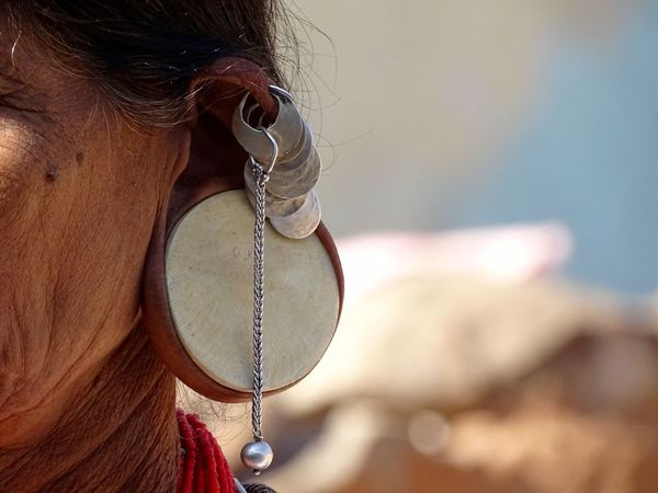 Close-up Day Head Lobe With Wide Hole One Person Outdoors Real People Tribal Women Women With Strange Earrings