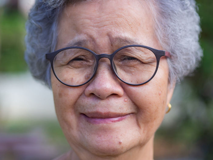 Close-up of face elderly woman smiling happiness.
