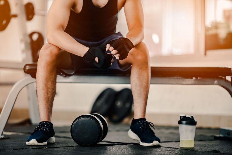 Healthy Lifestyle Lifestyles Exercising One Person Indoors  Sports Clothing Sport Sitting Exercise Equipment Real People Sports Training Gym Weight Young Adult Weight Training  Workout Exercising Low Section Adult Focus On Foreground Leisure Activity Shoe