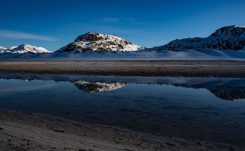 Snow capped mountain and sand beach with reflection in water Winter Snow Covered Landscape Sea Snowscape Reflection Reflections In The Water Europe Clear Blue Sky Clear Water Blue Sky Water Beauty In Nature Reflection Sky Scenics - Nature Tranquility Tranquil Scene Nature Mountain Snow Land Winter Sea Cold Temperature No People Blue Day Outdoors Non-urban Scene Snowcapped Mountain