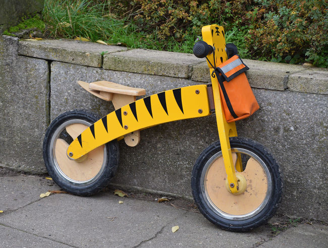 Yellow small bike for kid Kids Bike Paint Paint The Town Yellow Transportation Bicycle Bike Child Bike Childhood Close-up Day High Angle View No People Outdoors Tiger Walking Wood - Material Wooden Yellow Yellow Color