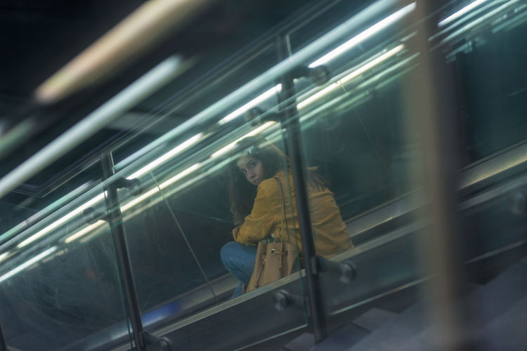 Young woman on escalator