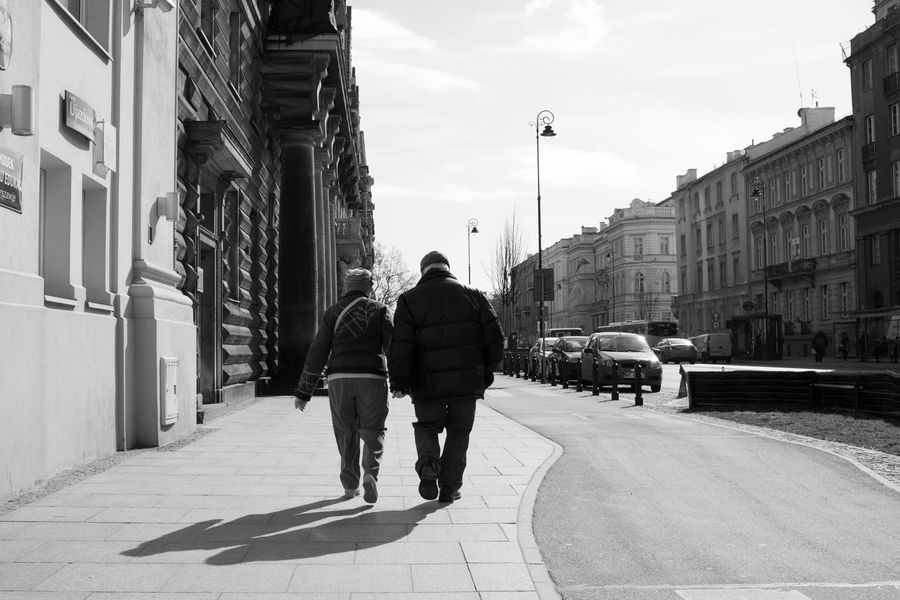 Aged Aged Beauty Architecture Building Exterior Built Structure Car City City Life Couple Full Length Lifestyles Love Lovers Men Mode Of Transport Old People On The Move Rear View Road Sky Street The Way Forward Transportation Walk Walking