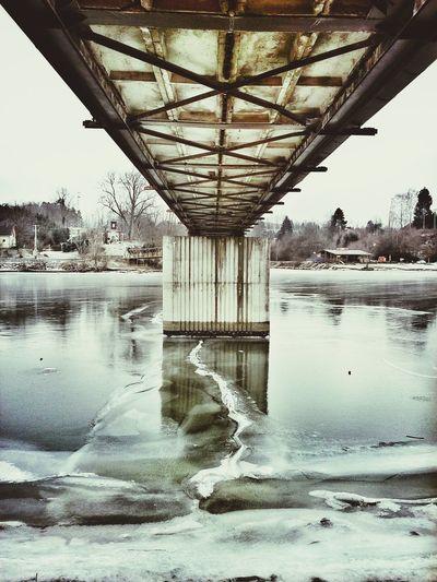 Winter Frozen River Cracked Ice Under The Bridge Bridge Concretewalls Reflections White Sky Perspective