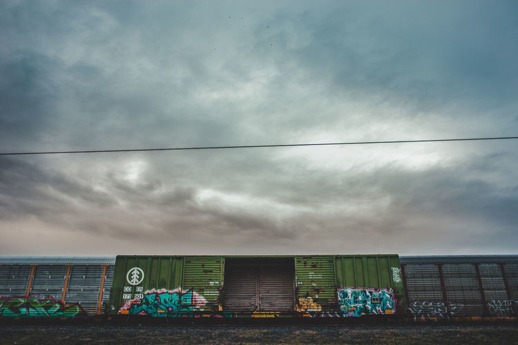 Graffiti Train Tracks Architecture Building Exterior Built Structure Cloud - Sky Day Nature No People Outdoors Sky Train