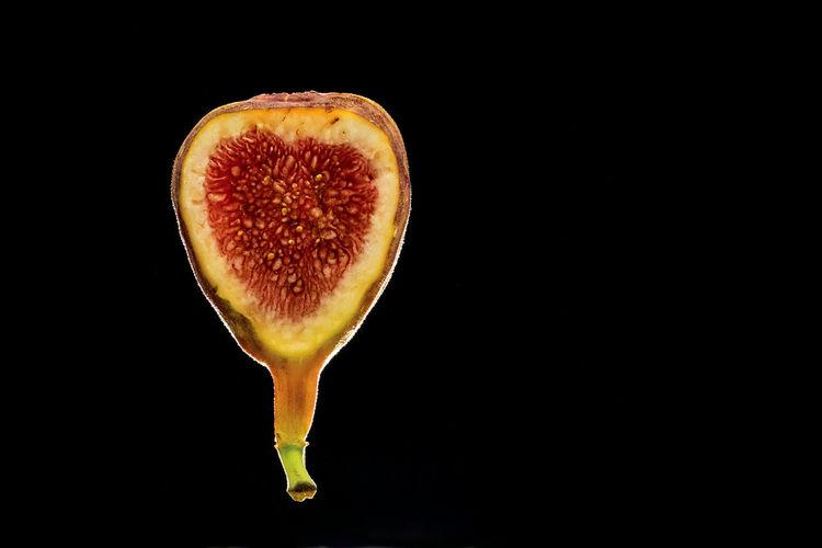 Back-lit fig Back-lit Fig Black Background Close-up Fig Food Food And Drink Freshness Fruit Halved Healthy Eating Healthy Lifestyle No People Seed SLICE Studio Shot