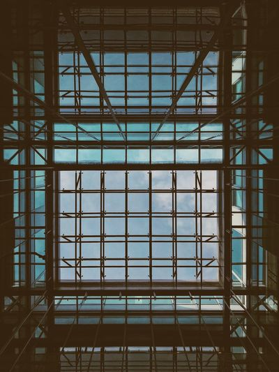 Low angle view of skylight in building Built Structure Architecture No People Low Angle View Building Pattern Metal Building Exterior Glass - Material Full Frame Day Modern Outdoors Ceiling Window Backgrounds Grid Transparent Nature Skylight Office Building Exterior Directly Below