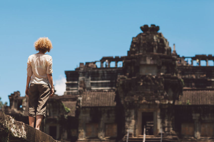 Siem Reap Cambodia Angkor Curly Hair Girl Architecture Built Structure Sky Rear View History Real People The Past Building Exterior Leisure Activity One Person Lifestyles Nature Day Travel Destinations Travel Tourism Sunlight Clear Sky Focus On Foreground Hairstyle Outdoors Looking At View