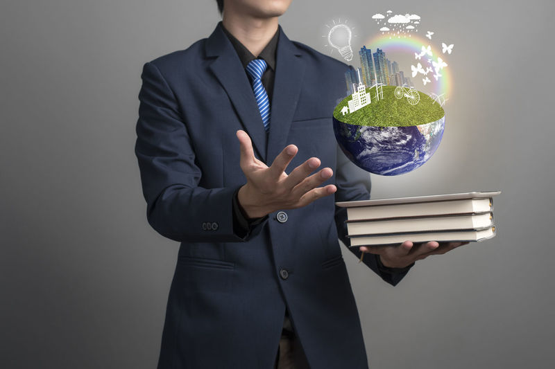 Business Businessman Care Clean Conservation Environmental Conservation Global Gray Background Innovation Knowledge Nature One Person People Recycle Save Earth Save The Nature Save The World Savetheplanet Suit Technology