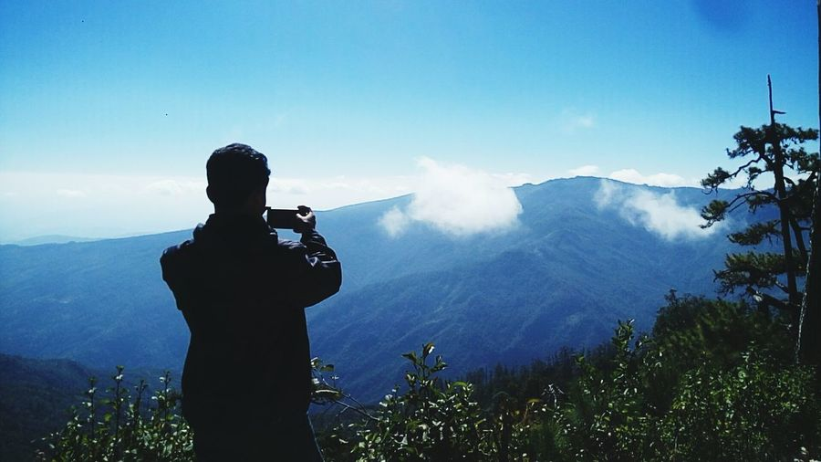 One Person Activity Mountain Adult Photography Themes Men Technology Occupation Photographing Sky Nature Holding Beauty In Nature Camera - Photographic Equipment Cloud - Sky Standing Fog Scenics - Nature Outdoors Photographer Myanmar Chin, Myanmar Leisure Activity