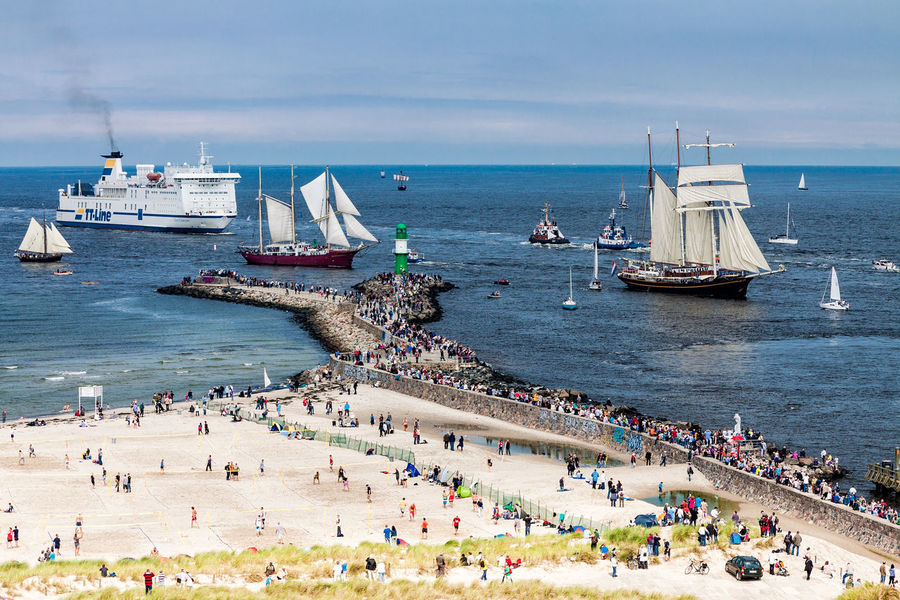 View to the mole in Warnemuende, Germany. Beach Coast Day Ferry Holiday Lighthouse Mole Nautical Vessel Outdoors People Rostock Sailing Ships Sea Ships Shore Tall Ship Tourism Travel Destinations Vacation Warnemuende Water Windjammer