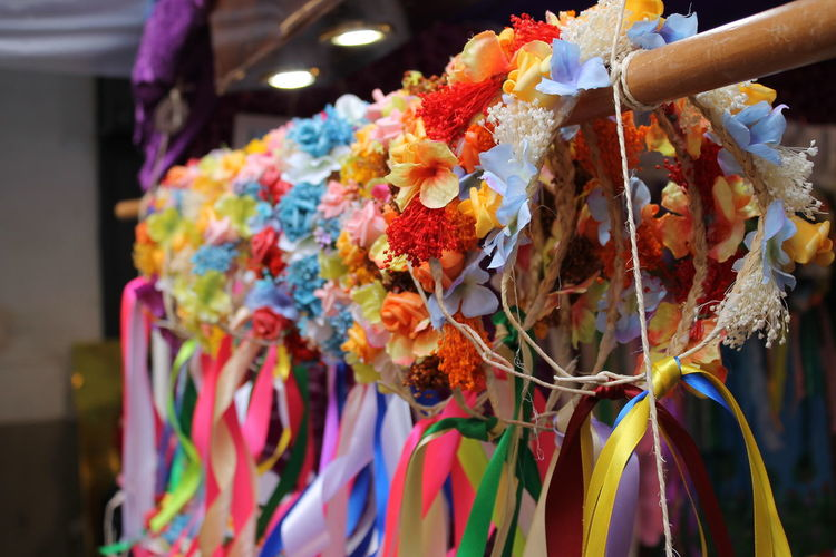 Close-up of flower tiaras hanging in row