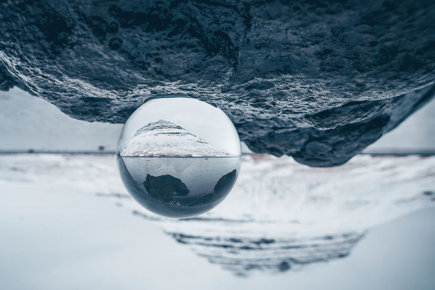 Kirkjufell mountain in Iceland through glass ball Crystal Ball Glass Ball Iceland Kirkjufell Kirkjufell Mountain Reflection Beauty In Nature Close-up Cold Temperature Creative Crystal Ball Photography Day Focus On Foreground Frozen Ice Land Nature No People Outdoors Reflection Scenics - Nature Sea Selective Focus Snow Upside Down Water Winter
