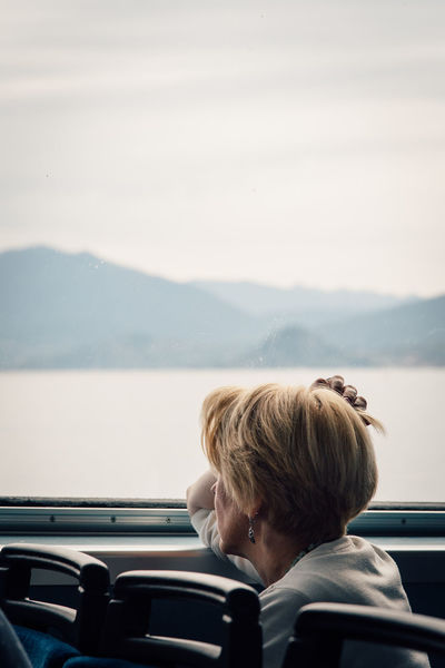 Rear View Transportation Headshot Water Day Journey Mode Of Transport Adults Only Travel Adult People Road Trip Leisure Activity One Person Outdoors Women Sky Nostalgia Nostalgic  Dreaming Thinking Life Sadness Lake Ferryboat Fresh On Market 2017
