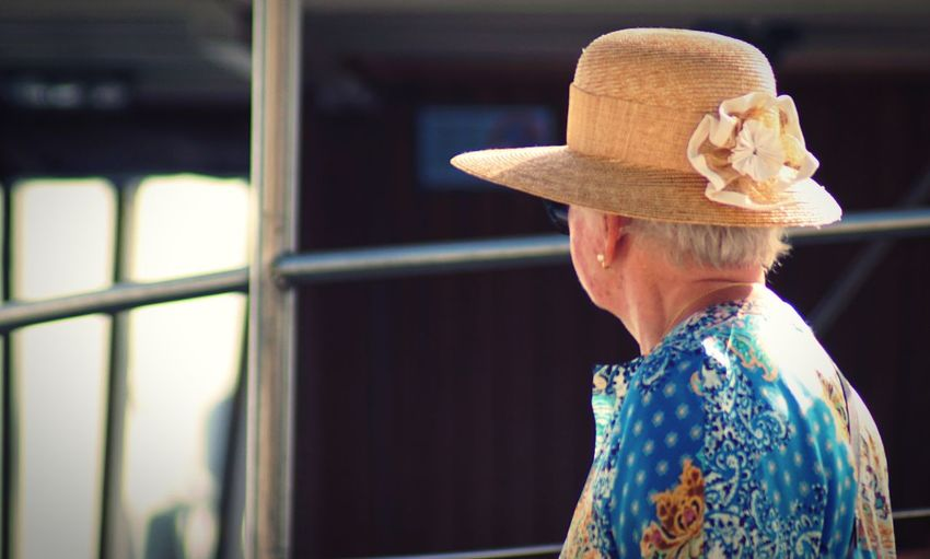 An old lady Hat One Person Clothing Adult Senior Adult Real People Headshot Rear View Day Lifestyles Women Focus On Foreground Senior Women Casual Clothing Portrait