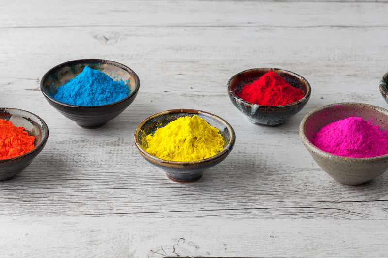 High angle view of colorful powder paint on table