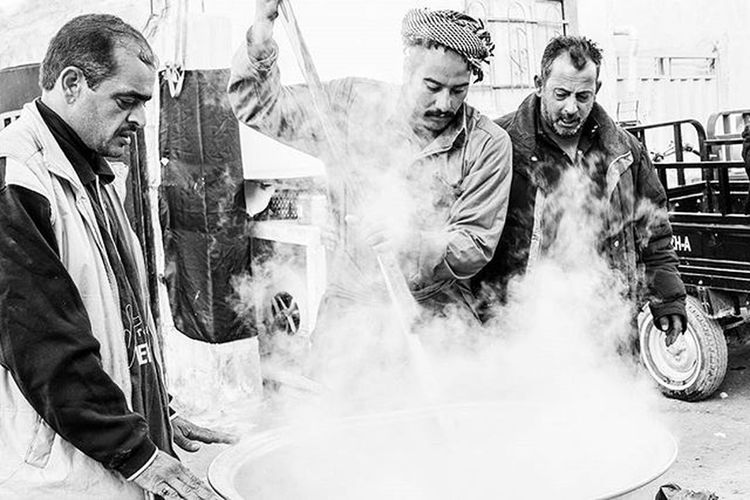 These three individuals prepare a huge pot of food for the millions of walkers from Najaf to Karbala. Iraqi people are everywhere during the walk, spending days and nights cooking hot meals for the walkers. Walk Karbala Najaf Cooking Cook  Prepare Food Neverhungry Hussain Love Generous Steam Rice Instadaily Arbaeen2015 Instapic FaithInHumanityRestored Ztprod