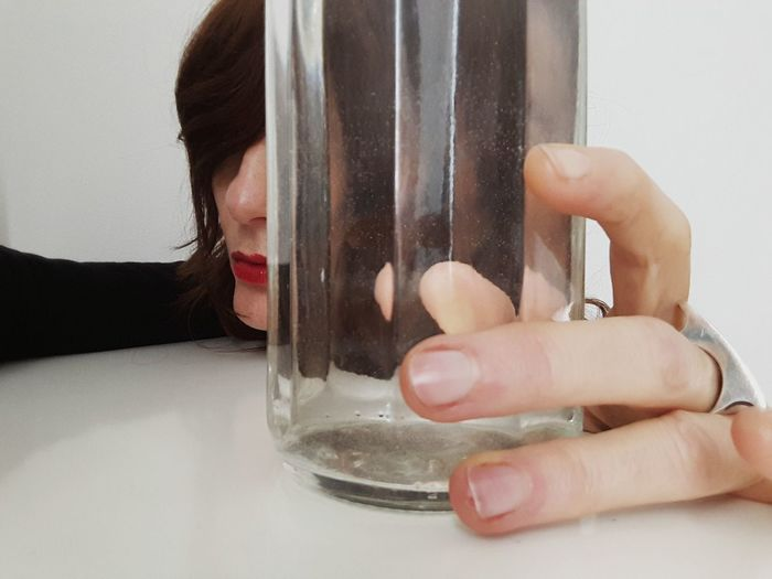 red lips Water One Person Trasparence Glass - Material Glass Glass Reflection Women Of EyeEm Human Hand Young Women Women White Background Water Technology Healthcare And Medicine Close-up Fingernail Finger Human Finger Transparent Index Finger