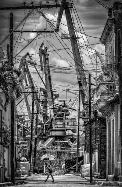 Umbrella and Cranes Black & White Cuba Harbor Harbour Havanna, Cuba Light Blackandwhite Blackandwhite Photography Crane Streetphoto_bw Streetphotography Structure Umbrella Walking EyeEmNewHere The Street Photographer - 2018 EyeEm Awards The Street Photographer - 2018 EyeEm Awards