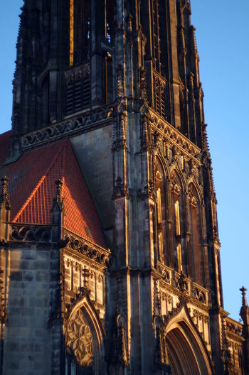 Churches in Münster, germany, during sunset Architecture Built Structure Building Exterior Travel Destinations Place Of Worship Building Travel Religion Sky City Day Low Angle View Tower Belief Nature No People Outdoors Skyscraper Spire  Ornate Lambertikirche