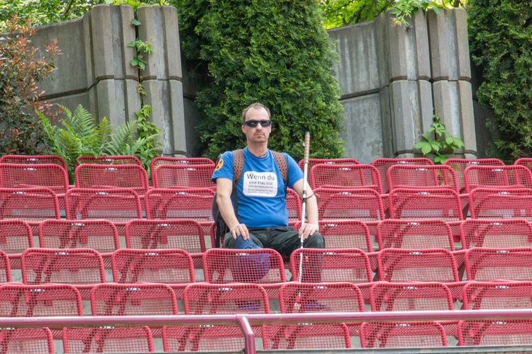 Portrait of man sitting on chair