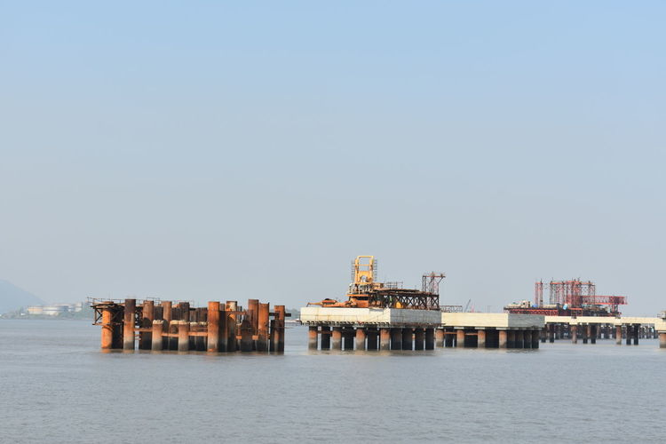 Panoramic view of pier on sea against clear sky