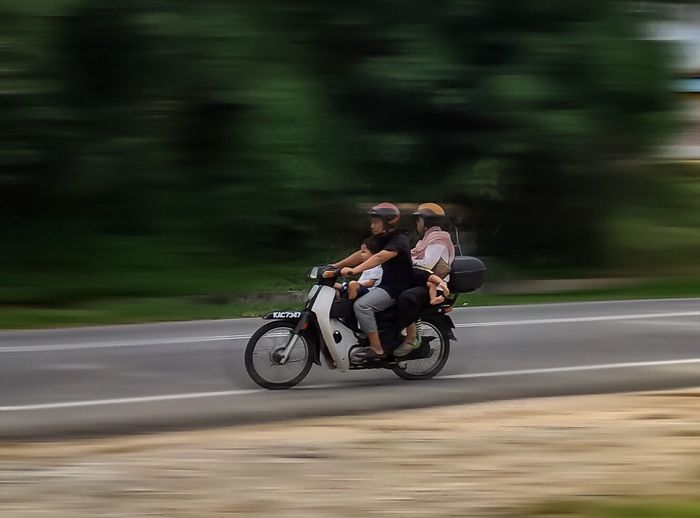 Panning Mode Two People Transportation Togetherness Real People Blurred Motion Speed Road Land Vehicle Motion Mode Of Transport Bonding Lifestyles Outdoors Malaysia